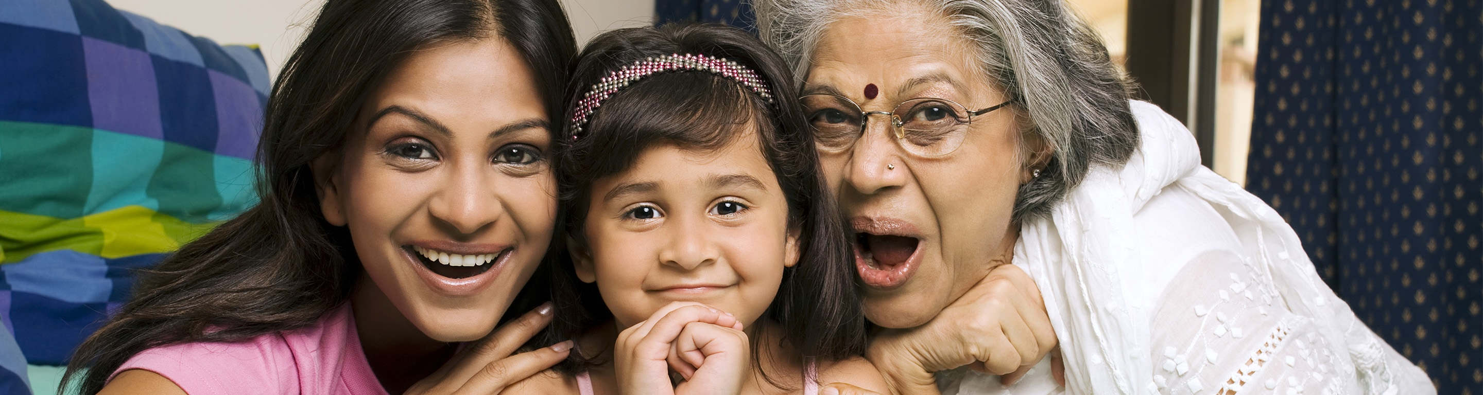 3 generations of women smiling - genetic screening - Axia Women's Health