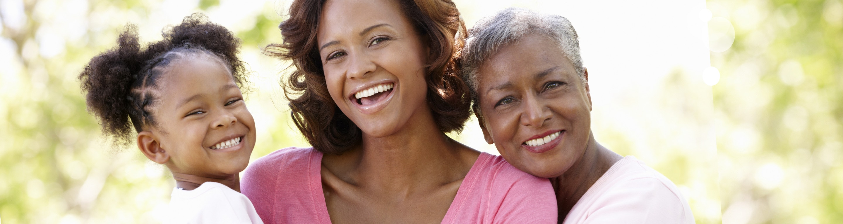 3 generations of women smiling and hugging - Weight Management - Axia Women's Health