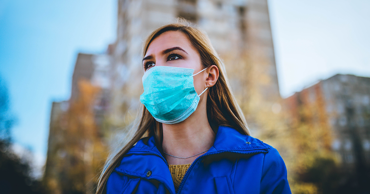 woman wearing mask - Is the COVID-19 Vaccine Safe -Axia Women's Health