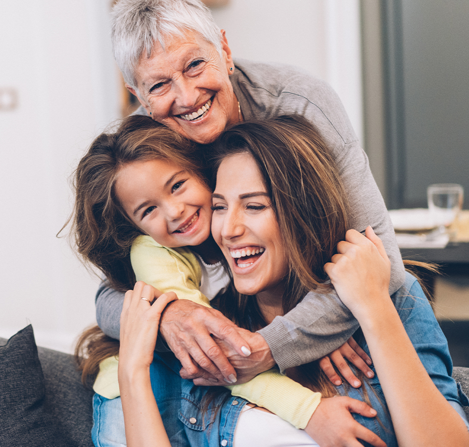 3 generations of women hugging - more connected care - Axia Women's Health